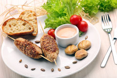 Minced meatballs baked as skewers with sesame seeds Royalty Free Stock Photography