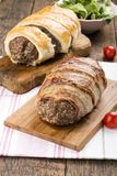 Minced meatloaf wrapped in bacon royalty free stock photo