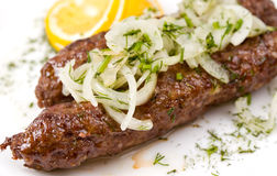 Minced mutton chops, macro. Minced mutton chops fried on skewers, macro stock image