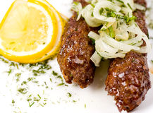 Minced mutton chops, macro. Minced mutton chops fried on skewers, macro royalty free stock photo