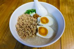 Minced pork congee with egg, fresh ginger royalty free stock photography