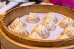 Minced pork and crab dumpling with soup, xiao long bao Stock Photos