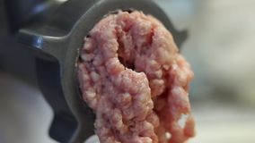 Minced pork meat out off grinder stock video footage