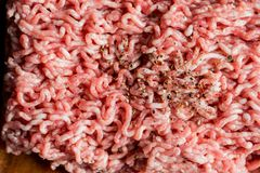 Minced pork, Minced meat texture close up - top view minced meat raw fresh macro. Close-up with pepper, salt spices cooking cutlet. Minced pork, Minced meat Stock Images