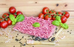 Minced Veal Meat ,Cherry Tomatoes ,Himalayan Salt and Pepper Stock Image