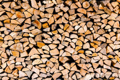 Minced wooden logs stacked in woodpile Royalty Free Stock Photo
