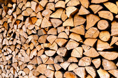 Minced wooden logs stacked in woodpile Royalty Free Stock Images