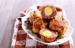 Mincemeat balls with eggs inside. Scotch eggs Royalty Free Stock Photos