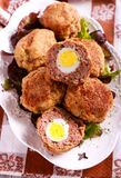 Mincemeat balls with eggs inside. Scotch eggs Stock Photos