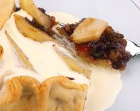 Mincemeat and pear tart, with cream. Cinnamon and nutmeg Stock Image