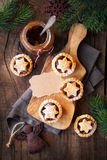 Mincemeat pies. Traditional festive Christmas mince pies with a jar of homemade mincemeat and an empty tag. Overhead view Royalty Free Stock Photography