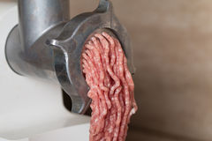 Mincer with fresh chopped meat Royalty Free Stock Photo
