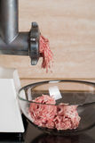 Mincer with fresh chopped meat Stock Photography