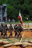Mincer Nivelle battle reenactment. Soldiers march with German flag. Royalty Free Stock Image