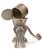 Mincer processes tin in metal mince. Royalty Free Stock Photo
