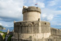 Minceta Tower at sanset lights and Dubrovnik medieval old town city walls, Croatia. Ancient european landmark heritage fort history architecture castle fortress royalty free stock photo