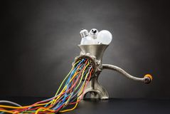 Mincing machine is grinding up light bulbs Royalty Free Stock Photography