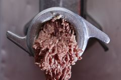 Mincing machine and meat. Preparation of minced raw meat Royalty Free Stock Photo