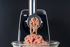 Mincing machine and meat. Preparation of minced raw meat Royalty Free Stock Images