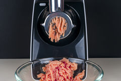 Mincing machine and meat. Preparation of minced raw meat Stock Image