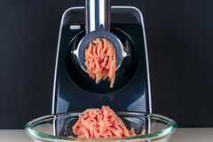 Mincing machine and meat Royalty Free Stock Images