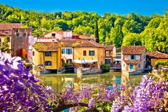 Mincio river and idyllic village of Borghetto view. Veneto region of Italy royalty free stock photos