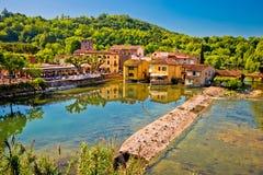 Mincio river and idyllic village of Borghetto view. Veneto region of Italy Royalty Free Stock Photo