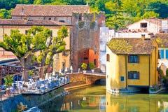 Mincio river and idyllic village of Borghetto view. Veneto region of Italy Stock Images