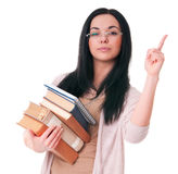 Mind that!. Young woman with books draws attantion isolated on white background Stock Photos