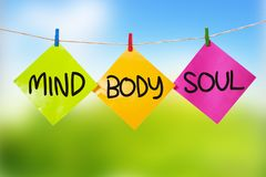 Mind Body Soul. Inspirational text. Mind Body Soul. Motivational inspirational quotes words. Colorful Paper with blurred background stock photo