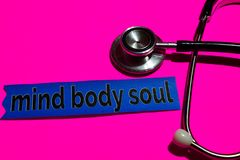 Mind Body Soul on the print paper with medicare Concept stock photos