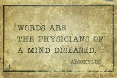Mind diseased Aeschylus. Words are the physicians of a mind diseased - famous ancient Greek tragedian Aeschylus quote printed on grunge vintage cardboard stock image