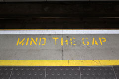 Mind the gap. Notice at a tube station Stock Photo
