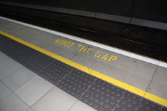 Mind the gap. Sign at a train station Royalty Free Stock Images