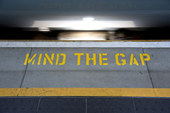 Mind the Gap. Image of the words Mind The Gap on a train platform stock images
