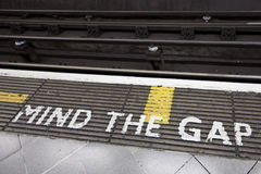 Mind the gap. London underground mind the gap painted on the floor royalty free stock images