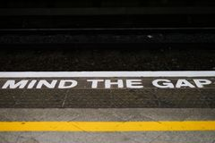 Mind the gap alert. Train station in England. Royalty Free Stock Photography