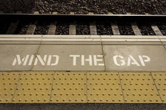 Mind the gap. On a national rail platform Royalty Free Stock Photo