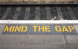 Mind the gap sign. Stock Photo