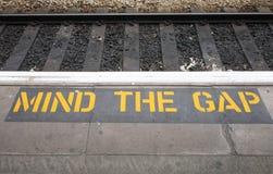 Mind the gap sign. Mind the gap sign on a British railway platform Stock Photo