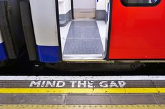 Mind the gap sign on the platform in the London Underground. LONDON, ENGLAND -12 MARCH 2015- The London Underground (familiarly called the Tube) is a public Royalty Free Stock Image