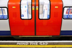 Mind the gap sign on the platform in the London Underground. LONDON, ENGLAND -12 MARCH 2015- The London Underground (familiarly called the Tube) is a public Stock Photos