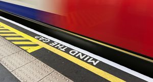 Mind the gap sign with speeding train in London underground royalty free stock photos