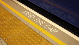 Mind the gap sign on the subway train platform. Stock Image
