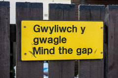 Mind the gap warning sign on railway platform Royalty Free Stock Photo