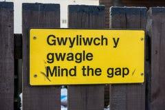 Mind the gap warning sign on railway platform Royalty Free Stock Photo