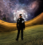Mind of man. Man in field in fantasy landscape Royalty Free Stock Photography