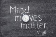 Mind moves Virgil. Mind moves matter - quote of ancient Roman poet Virgil written on chalkboard with vintage precise stopwatch royalty free stock images