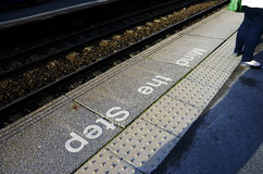 Mind the step sign on railway platform floor Royalty Free Stock Photo