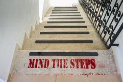 Mind The Steps. Words at the top of some steps warning of danger royalty free stock images
